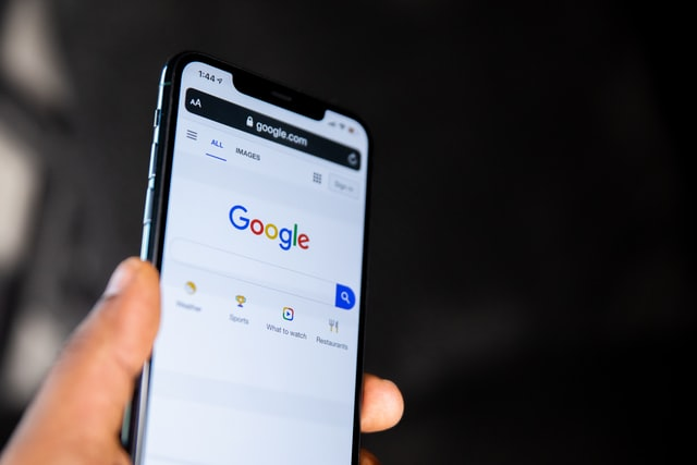 a mobile phone with Google on the screen