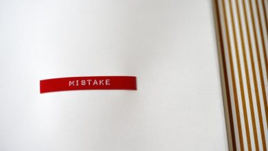 "A red sticker with a word ""mistake"" written on it"